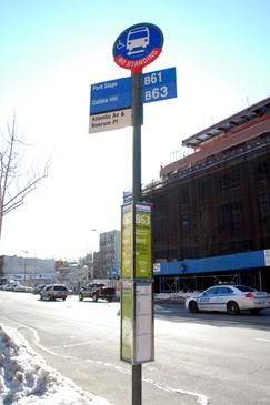 bus stop pole and guide-a-ride schedule box